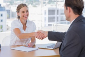Interviewee shaking employer's hand: WorkingManLaw Employment Law Blog