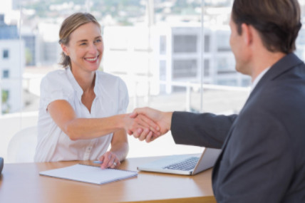 Interviewee shaking employer's hand: WorkingManLaw Employment Law Blog