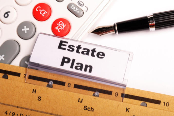 Estate plan with pen and calculator: WorkingManLaw Estate Planning Blog