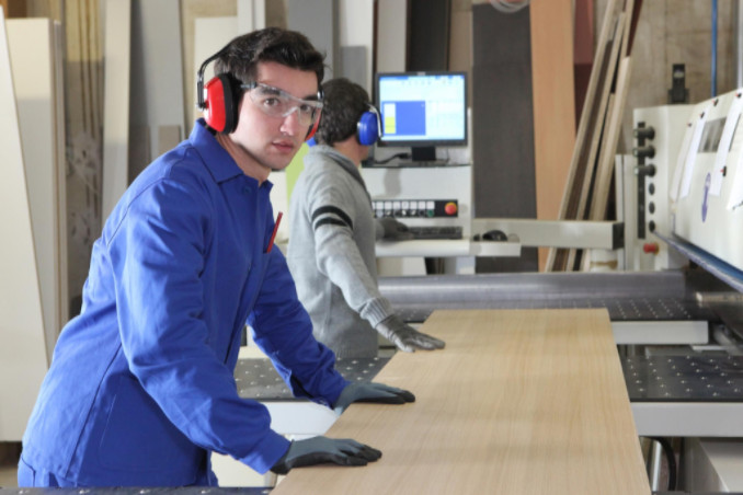 Employee wearing headset at work: WorkingManLaw Workplace Safety Blog
