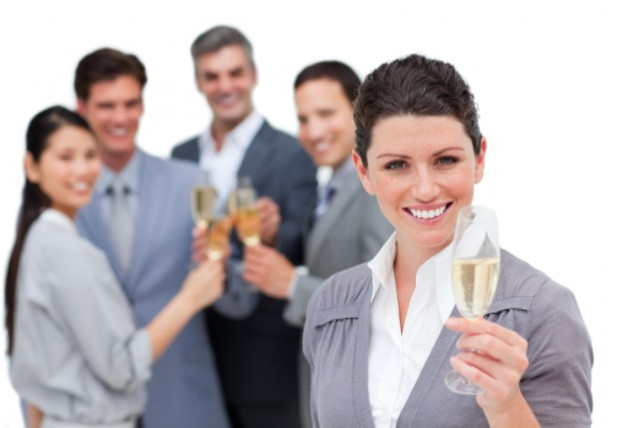 workers at holiday party toasting champagne