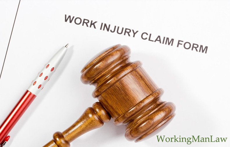 pen and gavel on top of a workplace injury form